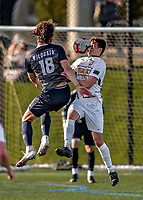 9 April 2021: University of Vermont Catamount Men's Soccer Defender Noah Egan, a Sophomore from Irvine, CA, goes up against University of New Hampshire Wildcat Forward Paul Mayer, a Graduate Student from Strasbourg, France, in first-half action at Virtue Field in Burlington, Vermont. The Catamounts fell to the visiting Wildcats 2-1 for their first loss of the season in America East, Division 1 play. Mandatory Credit: Ed Wolfstein Photo *** RAW (NEF) Image File Available ***