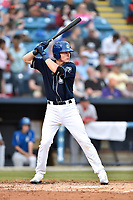 Asheville Tourists first baseman Tyler Nevin (23) awaits a pitch during a game against the Greenville Drive at McCormick Field on April 13, 2017 in Asheville, North Carolina. The Tourists defeated the Drive 3-1. (Tony Farlow/Four Seam Images)