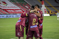 IBAGUE - COLOMBIA, 30-03-2021: Jugadores del Tolima celebran después de anotar el segundo gol durante partido entre Deportes Tolima y Atlético Nacional por la fecha 16 como parte de la Liga BetPlay DIMAYOR I 2021 jugado en el estadio Manuel Murillo Toro de la ciudad de Ibagué. / Players of Tolima celebrate after scoring the second goal during match between Deportes Tolima and Atletico Nacional for the date 16 as part of BetPlay DIMAYOR League I 2021 played at Manuel Murillo Toro stadium in Ibague. Photo: VizzorImage / Juan Torres / Cont