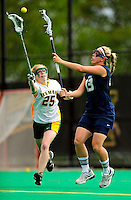 1 May 2010: University of Vermont Catamount attacker Lindsay Hegarty (25), a Junior from Andover, MA, battles attacker University of New Hampshire Wildcat attacker Deb Dale (13), a Junior from East Northport, NY, at Moulton Winder Field in Burlington, Vermont. The Lady Catamounts fell to the visiting Wildcats 18-10 in the last game of the 2010 regular season. Mandatory Photo Credit: Ed Wolfstein Photo