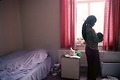 Kenyan asylum-seeker in a teenage mother and baby hostel in Croydon.  She arrived at Gatwick Aitport aged 15 and pregnant after her house was burnt down and most of her family were killed.