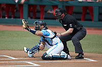 North Carolina Tar Heels catcher Tomas Frick (52) sets a target as home plate umpire Adam Dowdy looks on during the game against the North Carolina State Wolfpack at Boshamer Stadium on March 27, 2021 in Chapel Hill, North Carolina. (Brian Westerholt/Four Seam Images)