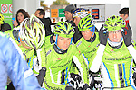 Cannondale Pro Cycling riders take shelter in a forecourt as they wait for the race to restart in Cogoleto after heavy snow forces the race organizers to abandon part of the race over Passo del Turchino during the 104th edition of the Milan-San Remo cycle race, 17th March 2013 (Photo by Eoin Clarke 2013)