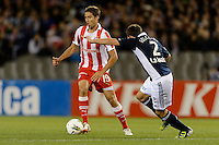 MELBOURNE, AUSTRALIA - MAY 19: David Fuster of Olympiakos controls the ball during a match between Melbourne Victory and Olympiakos FC at Etihad Stadium on 19 May 2012 in Melbourne, Australia. (Photo Sydney Low / AsteriskImages.com)