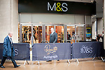 """Expected queues failed to materialise  at Marks and Spencer for..Rosie Huntington-Whitely.At M&S Oxford St.to promote her new range of underwear - lingerie -.""""Rosie for Autograph."""".On the way in she paused to kiss strange long haired blonde man.....Pic by Gavin Rodgers/Pixel 8000 Ltd"""