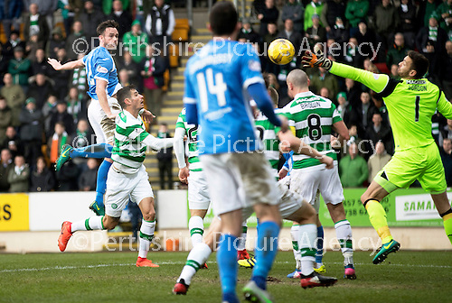 St Johnstone v Celtic…05.02.17     SPFL    McDiarmid Park<br />Keith Watson gets above Nir Bitton to score for saints<br />Picture by Graeme Hart.<br />Copyright Perthshire Picture Agency<br />Tel: 01738 623350  Mobile: 07990 594431