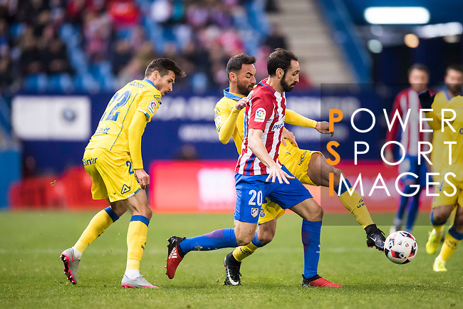 """Juan Francisco Torres Belen """"Juanfran"""" of Atletico de Madrid competes for the ball with Helder Lopes (l) and Jeronimo Figueroa Cabrera """"Momo"""" of UD Las Palmas during their Copa del Rey 2016-17 Round of 16 match between Atletico de Madrid and UD Las Palmas at the Vicente Calderón Stadium on 10 January 2017 in Madrid, Spain. Photo by Diego Gonzalez Souto / Power Sport Images"""
