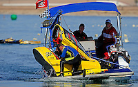 Nov. 22, 2008; Chandler, AZ, USA; Rescue personnel extract the capsule containing top fuel hydro driver James Ray from the water after crashing during qualifying for the Napa Auto Parts World Finals at Firebird Lake. Ray was okay in the accident and was transported to a local hospital for further evaluation. Mandatory Credit: Mark J. Rebilas-