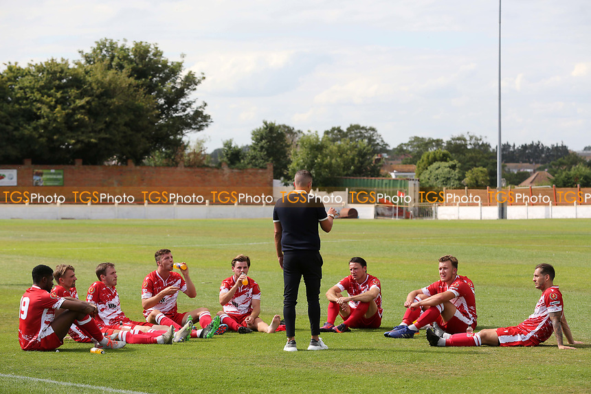 Ramsgate Manager, Matt Longhurst, speaks to his players at half-time as they observe social distancing guidelines  during Ramsgate vs Folkestone Invicta, Friendly Match Football at Southwood Stadium on 1st August 2020