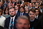 © Joel Goodman - 07973 332324 . 02/10/2016 . Birmingham , UK . THERESA MAY sitting in the audience during the Chairman's speech during the first day of the Conservative Party Conference at the International Convention Centre in Birmingham . Photo credit : Joel Goodman