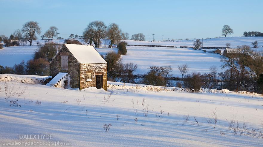 Stone barn after heavy snowfall, Bonsall village, Derbyshire, Peak District.