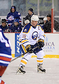 Danny Gare (18) skates up ice during The Frozen Frontier Buffalo Sabres vs. Rochester Amerks Alumni Game at Frontier Field on December 15, 2013 in Rochester, New York.  (Copyright Mike Janes Photography)