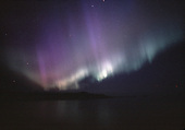 Northern Lights over Partridge Bay near Marquette Michigan on Lake Superior. Sugar Loaf Moountain  is along the horizon.
