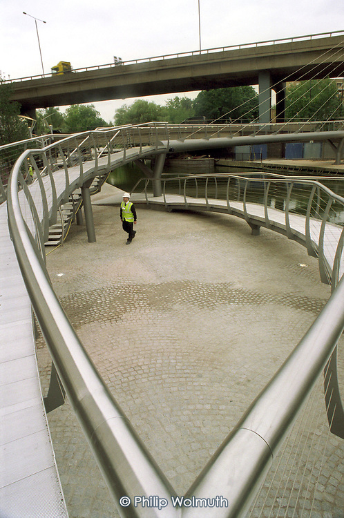 The Westway flyoner passes a new footbridge over the Regent's Canal, part of the redevelopment of Paddington Basin, City of Westminster, London.