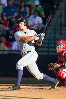 Aaron Judge (35) of the Charleston RiverDogs follows through on his swing against the Hickory Crawdads at L.P. Frans Stadium on May 24, 2014 in Hickory, North Carolina.  The Crawdads defeated the RiverDogs 7-3.  (Brian Westerholt/Four Seam Images)