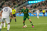 Portland, Oregon - Wednesday September 25, 2019: Diego Valeri #8 dribbles the ball during a regular season game between Portland Timbers and New England Revolution at Providence Park on September 25, 2019 in Portland, Oregon.