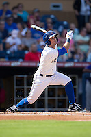 Joey Rickard (4) of the Durham Bulls follows through on his swing against the Louisville Bats at Durham Bulls Athletic Park on August 9, 2015 in Durham, North Carolina.  The Bulls defeated the Bats 9-0.  (Brian Westerholt/Four Seam Images)