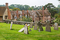 UK, England, Ewelme.  Graveyard of St. Mary the Virgin Church, with Almshouse and School in background.