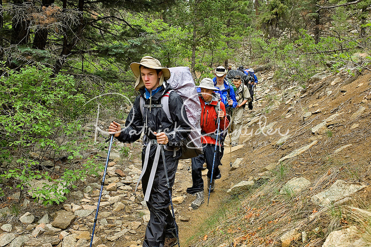 Photo story of Philmont Scout Ranch in Cimarron, New Mexico, taken during a Boy Scout Troop backpack trip in the summer of 2013. Photo is part of a comprehensive picture package which shows in-depth photography of a BSA Ventures crew on a trek.  In this photo BSA Venture Crew Scouts make their way across a rocky trail in the backcountry at Philmont Scout Ranch.   <br /> <br /> The  Photo by travel photograph: PatrickschneiderPhoto.com