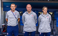 PARIS,  - JUNE 16: Tony Gustavsson, Grame Abel, and Dawn Scott stand at the bench during a game between Chile and USWNT at Parc des Princes on June 16, 2019 in Paris, France.