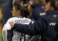 Mia Garciaparra and Brandi Chastain watch their teamates during a 5-0 victory over Mexico at the Home Depot Center in Carson, Calif., Tuesday, Dec., 7, 2004.
