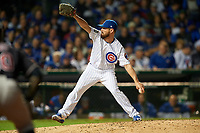 Chicago Cubs pitcher Travis Wood (37) delivers a pitch in the seventh inning during Game 4 of the Major League Baseball World Series against the Cleveland Indians on October 29, 2016 at Wrigley Field in Chicago, Illinois.  (Mike Janes/Four Seam Images)