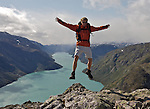 Man jumping close the famuos edge Besseggen in Jotunheimen, Norway