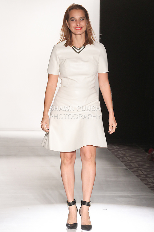 """Fashion designer Michelle Ann thanks audience for attending her Michelle Ann Fall Winter 2015 """"Glimmerati"""" collection runway show during the Designer's Collective Fall Winter 2015 fashion show for Fashion Gallery New York Fashion Week Fall 2015."""