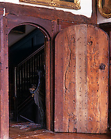 The open door leads from the Great Hall to the main staircase