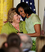 United States first lady Michelle Obama (R) embraces Irish Prime Minister Enda Kenny's wife, Fionnuala, during a reception in the East Room of the White House, March 20, 2012, in Washington, DC. President Obama and Kenny concluded a working day devoted to discussions on economic matters, Ireland's peace keeping participations and foreign policy issues like Syria and Iran.         .       .Credit: Mike Theiler / Pool via CNP