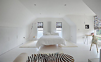 BNPS.co.uk (01202 558833)<br /> Pic: Mullucks/BNPS<br /> <br /> Bedroom after.<br /> <br /> A retired couple dubbed 'the accidental upsizers' have put their luxury home on the market for a whopping £750,000.<br /> <br /> Jean and Desmond Lawton bought a suburban bungalow three years ago as they looked to downsize from a large property.<br /> <br /> But they soon decided that they didn't like the dated decour of the humble home and transformed it beyond recognition.<br /> <br /> They knocked down every internal retaining wall bar one to create an open-plan space and built a single-storey extension to the rear.