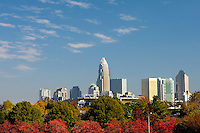 Fall colors are shown below the skyline in uptown Charlotte, NC.