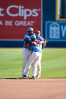 Spokane Indians outfielders Starling Joseph (39), Julio Pablo Martinez (27), and Tanner Gardner (44) celebrate after clinching their Division after a Northwest League game against the Vancouver Canadians at Avista Stadium on September 2, 2018 in Spokane, Washington. The Spokane Indians defeated the Vancouver Canadians by a score of 3-1. (Zachary Lucy/Four Seam Images)