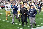 Nov. 7, 2015; Football chaplain Rev. Mark Thesing, C.S.C. runs onto the field against Pitt. (Photo by Matt Cashore)