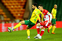 3rd November 2020; Carrow Road, Norwich, Norfolk, England, English Football League Championship Football, Norwich versus Millwall; Lukas Rupp of Norwich City under pressure from Shaun Williams of Millwall