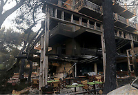 Pictured: A destroyed block of flats in the Mati area, Kokkino Limanaki near Rafina, Greece. Tuesday 24 July 2018<br /> Re: Deaths caused by wild forest fires throughout Greece.