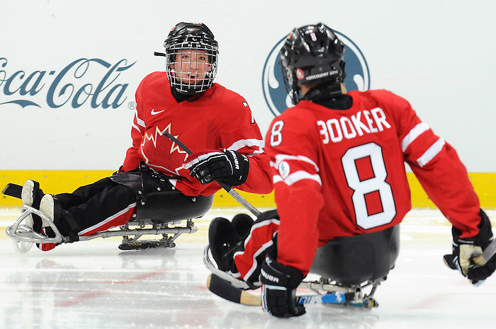 Marc Dorion and Jeremy Booker, Vancouver 2010 - Para Ice Hockey // Para-hockey sure glace.<br /> Team Canada plays against Sweden in Para Ice Hockey action // Équipe Canada joue contre la Suède dans un match de para-hockey sur glace. 14/03/2010.