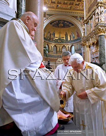 Pope Benedict XVI (L) washes 12 priests' feet during the evening mass commemorating Jesus' last supper with his 12 apostles on the evening before his Good Friday crucifixion at St Giovanni in Laterano Basilica in Rome, Italy on 01 April 2010.