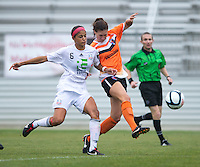 Katie Danehy (16) of the Charlotte Lady Eagles takes a shot while defended by Kimberly DeCesare (16) of the Long Island Rough Riders during the game at the Maryland SoccerPlex in Boyds, Maryland.  The Charlotte Lady eagles defeated the Long Island Rough Riders, 4-0, to advance to the W-League Eastern Conference Championship.