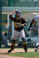 Pittsburgh Pirates catcher Jason Delay (64) throws to first base during a Florida Instructional League game against the Detroit Tigers on October 2, 2018 at the Pirate City in Bradenton, Florida.  (Mike Janes/Four Seam Images)