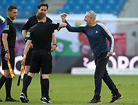 16th May 2020, Red Bull Arena, Leipzig, Germany; Bundesliga football, Leipzig versus FC Freiburg;  After the end of the game head coach Christian Streich elbow bumps with the referees on the pitch