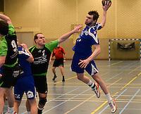 HBC Izegem -  Desselgemse Handbal : Bartosz Proszynski (r) met de aanval voor izegem voor Wim Verschaeve (links) <br /> foto VDB / BART VANDENBROUCKE