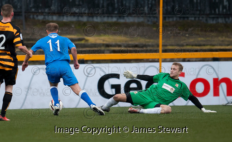Queen of the South's Iain Russell (11) goes around Alloa keeper Scott Bain before he scores their second goal.