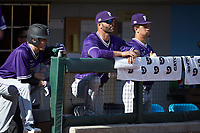 Furman Paladins head coach Brett Harker (center) watches from the dugout during the game against the Wake Forest Demon Deacons at BB&T BallPark on March 2, 2019 in Charlotte, North Carolina. The Demon Deacons defeated the Paladins 13-7. (Brian Westerholt/Four Seam Images)