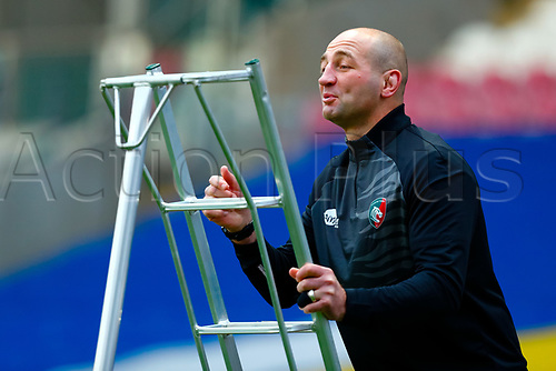 21st November 2020; Welford Road Stadium, Leicester, Midlands, England; Premiership Rugby, Leicester Tigers versus Gloucester Rugby; Leicester Tigers Head Coach Steve Borthwick climbs a ladder to catch balls during the pre-match warm-up