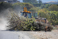 Pictured: Diggers work to clear the new site of the search, where rubble was deposited from the farmhouse where Ben Needham disappeared from in Kos, Greece. Thursday 06 October 2016<br />Re: Police teams led by South Yorkshire Police, searching for missing toddler Ben Needham on the Greek island of Kos have moved to a new area in the field they are searching.<br />Ben, from Sheffield, was 21 months old when he disappeared on 24 July 1991 during a family holiday.<br />Digging has begun at a new site after a fresh line of inquiry suggested he could have been crushed by a digger.