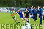 Aidan Breen Ballymac goes around Ronan Collins Gneeveguilla during their Junior Championship quarter final in Castleisland on Saturday