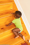 12 month old baby boy crawling up stairs
