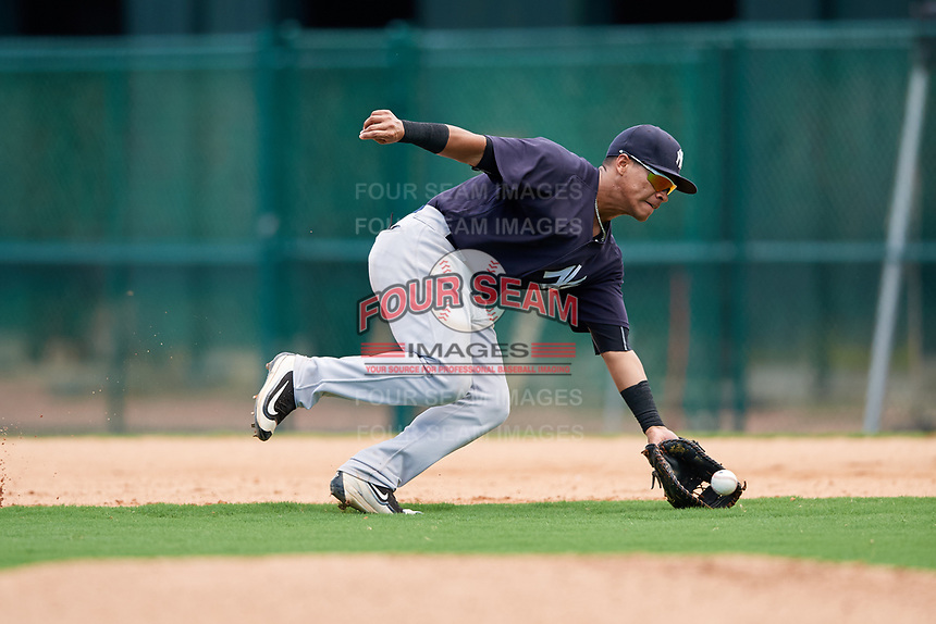 GCL Yankees West first baseman Jesus Graterol (31) fields a ground ball during the second game of a doubleheader against the GCL Braves on July 30, 2018 at Champion Stadium in Kissimmee, Florida.  GCL Braves defeated GCL Yankees West 5-4.  (Mike Janes/Four Seam Images)