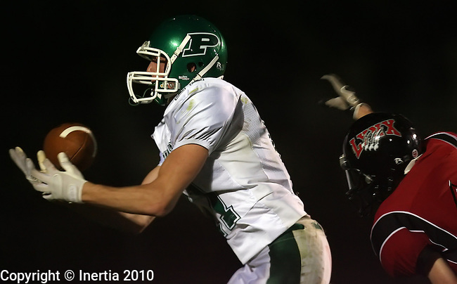 BRANDON, SD - OCTOBER 8: Parker McKittrick #11 of Pierre hauls in a pass for a touchdown in front of a Brandon Valley defender in the first quarter of their game Friday night at Brandon Valley High School. (photo by Dave Eggen/Inertia)